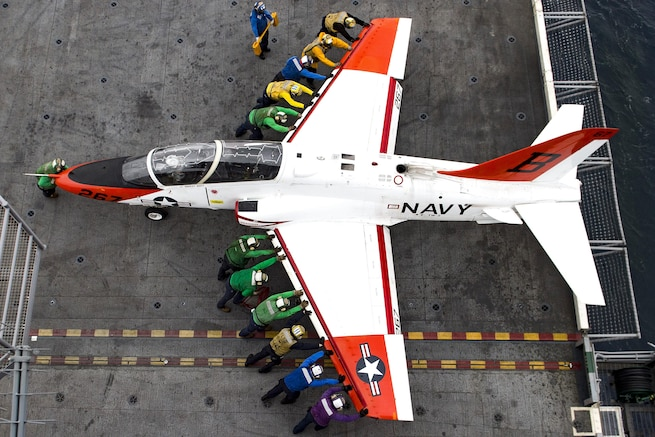 Sailors move a T-45C Goshawk on the flight deck of the USS Dwight D. Eisenhower in the Atlantic Ocean, Feb. 5, 2016. The aircraft carrier is preparing for Inspections and conducting carrier qualifications. Navy photo by Petty Officer 3rd Class Anderson W. Branch
