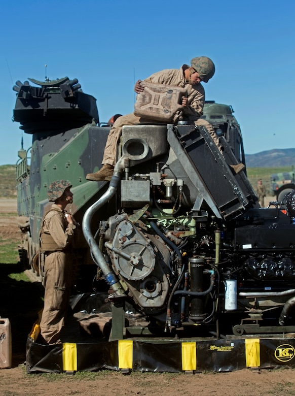 MARINE CORPS BASE CAMP PENDLETON, Calif. – Pfc. Celso Romero watches Lance Cpl. Salgado Chavez as he pours water into an assault amphibious vehicle engine at Camp Pendleton, Feb. 2, 2016. 3rd Assault Amphibious Battalion provides forward maintenance capabilities and allow for immediate restoration of AAVs that break down. Romero, from Fresno is an AAV driver with Company A., 3rd AAB. Chavez, from Seattle, Wash. is an AAV crewman with Co. A., 3rd AAB. (U.S. Marine Corps Photo by Lance Cpl. Justin E. Bowles)