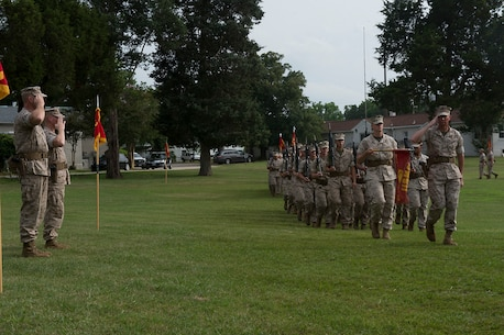 U.S. Marine Col. James W. Evans (left) and U.S. Marine Col. James M. Bright salute the companies of the Marine Corps Security Force Regiment during the pass and review at a change-of-command ceremony June 19 at Naval Weapons Station Yorktown, Va. The Marine Corps Security Force Regiment is the Marine Corps' largest regiment with over 4,000 Marines and sailors spread across the globe.