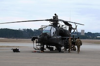 Soldiers prepare an AH-64 Apache helicopter for transport at Fort Bragg, N.C., Feb. 2, 2016. Army photo by Staff Sgt. Christopher Freeman