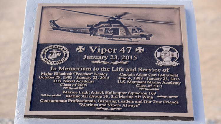 A plaque rests atop a memorial for two pilots with Marine Light Attack Helicopter Squadron 169, who passed away following a mishap last year, at the Strategic Expeditionary Landing Field, at Marine Corps Air Ground Combat Center Twenty nine Palms, Calif. Jan. 23, 2016. Marine Wing Support Squadron 374 completed the memorial in time to be unveiled on the anniversary of the incident.