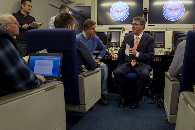 Defense Secretary Ash Carter speaks with reporters aboard an Air Force E4-B aircraft as he flies to Brussels, Feb. 9, 2016, to attend NATO meetings for defense ministers to discuss Russian aggression. Carter also will host a meeting on the fight against ISIL. DoD photo by Air Force Senior Master Sgt. Adrian Cadiz