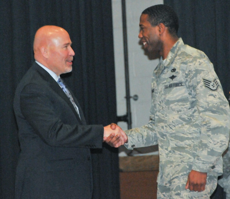 U.S. Congressman Thomas MacArthur, representing New Jersey's 3rd District, left, congratulates Air Force Staff Sgt. Mario Manago of the 621st Contingency Response Squadron upon his graduation Jan. 28 from the Army's Noncommissioned Officer Academy located on Joint Base McGuire-Dix-Lakehurst, N.J.