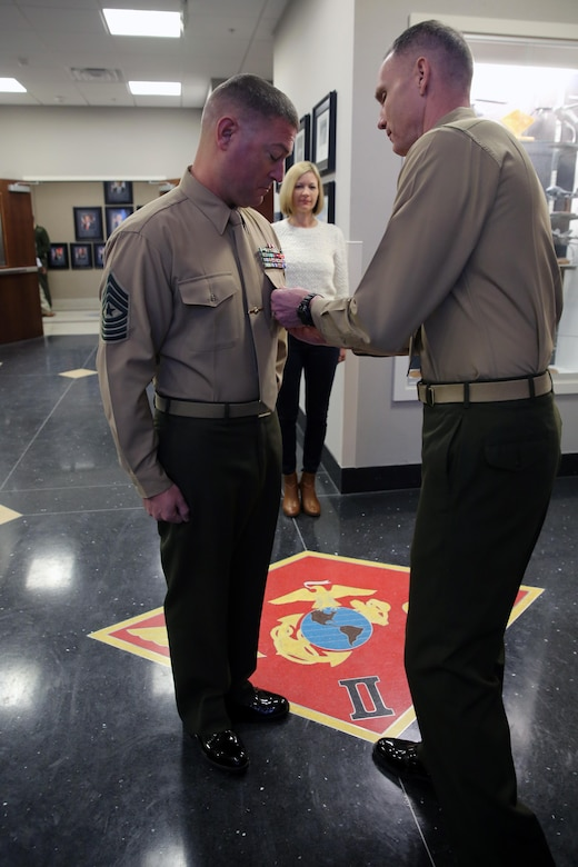 Maj. Gen. Gary L. Thomas (right) pins a Meritorious Service Medal on Sergeant Maj. James D. Vealey following the presentation of his award for outstanding meritorious service while serving as Sergeant Major of Combat Logistics Battalion 3, Combat Logistics Regiment 3, 3rd Marine Logistics Group, III Marine Expeditionary Force from May 2013 – July 2015 during a ceremony at Marine Corps Air Station Cherry Point, Jan 8. Thomas is the commanding general of 2nd Marine Aircraft Wing, and Vealey is the sergeant major of Marine Wing Headquarters Squadron 2. (U.S. Marine Corps Photo by Sgt. Grace L. Waladkewics/Released)
