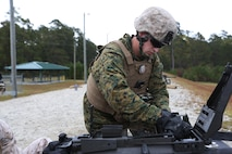 Lance Cpl. Austin Cable loads ammunition into an MK19 during a grenade and MK19 Grenade Launcher range at Marine Corps Base Camp Lejeune, N.C., Oct. 28, 2015. More than 70 Marines with 2nd Low Altitude Air Defense Battalion took turns handling the MK19 and handheld grenades during the familiarization range. The range offered Marines the opportunity to build confidence and proficiency skills on some of the crew-served weapons they operate while providing security in a deployed environment. Cable is a low altitude aerial defense gunner with the battalion. (U.S. Marine Corps photo by Cpl. N.W. Huertas/Released)