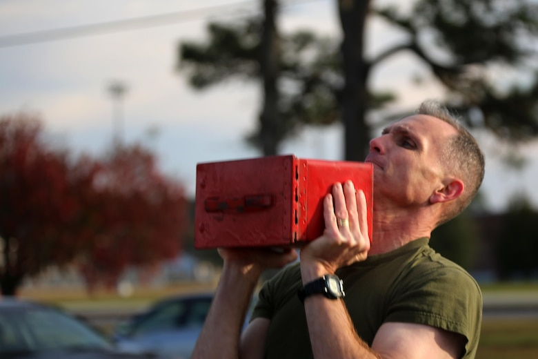 Maj. Gen. Gary Thomas executes ammo can lifts during a combat fitness test at Marine Corps Air Station Cherry Point, N.C., Dec. 4, 2015. 2nd MAW Marines maintain their combat readiness year-round in order to provide continuous support to the Marine Air-Ground Task Force. (U.S. Marine Corps photo by Cpl. N.W. Huertas/Released)