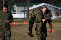 Maj. Gen. Gary Thomas fireman carries his partner through a field during a combat fitness test at Marine Corps Air Station Cherry Point, N.C., Dec. 4, 2015. The CFT is an annual requirement for all Marines to assess their physical capacity in a broad spectrum of combat-related tasks. 2nd MAW Marines maintain their combat readiness year-round in order to provide continuous support to the Marine Air-Ground Task Force. (U.S. Marine Corps photo by Cpl. N.W. Huertas/Released)