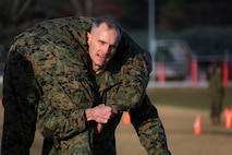 The 2nd Marine Aircraft Wing Commanding General, Maj. Gen. Gary L. Thomas carries his partner during a combat fitness test at Marine Corps Air Station Cherry Point, N.C., Dec. 4, 2015. The CFT is an annual requirement for all Marines to assess their physical capacity in a broad spectrum of combat-related tasks. 2nd MAW Marines maintain their combat readiness year-round in order to provide continuous support to the Marine Air-Ground Task Force. (U.S. Marine Corps photo by Cpl. N.W. Huertas/Released)