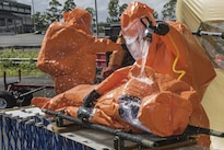 Army Staff Sgt. Rusty Greeno, right, rinses Air Force Tech. Sgt. August Hoaglund during decontamination for a man-down drill during proficiency training at Roberto Clemente Stadium in Carolina, Puerto Rico, Jan. 26, 2016. Greeno and Hoaglund are survey team chiefs assigned to the Vermont National Guard's 15th Civil Support Team. Vermont Army National Guard photo by Staff Sgt. Nathan Rivard
