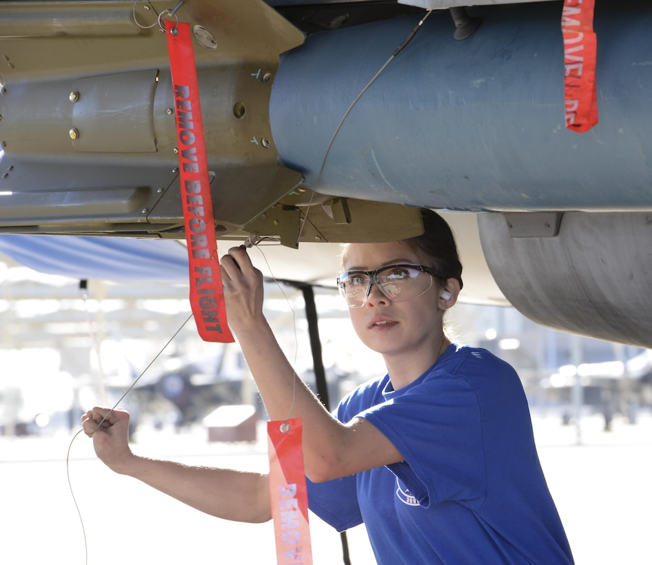 Airman 1st Class Nadiya Frick, 309th Aircraft Maintenance Unit load crew member, secures a weapon during the competition. Knowledge and communication were tools essential to the success of competing teams. (U.S. Air Force photo by Airman 1st Class Ridge Shan)
