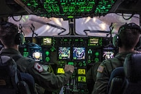 "Air Force Capts. Christopher Gilbert, left, and Roderick Mills land a C-17 Globemaster III at Pope Army Airfield, N.C., Feb. 4, 2015, after a mission to support ""large package week."" The exercise, which involves dropping large equipment and paratroopers onto drop zones, prepares Army and Air Force units for worldwide crisis and contingency operations. Gilbert and Mills are pilots assigned to the 517th Airlift Squadron, 3rd Airlift Wing. Air Force photo by Staff Sgt. Gregory Brook"
