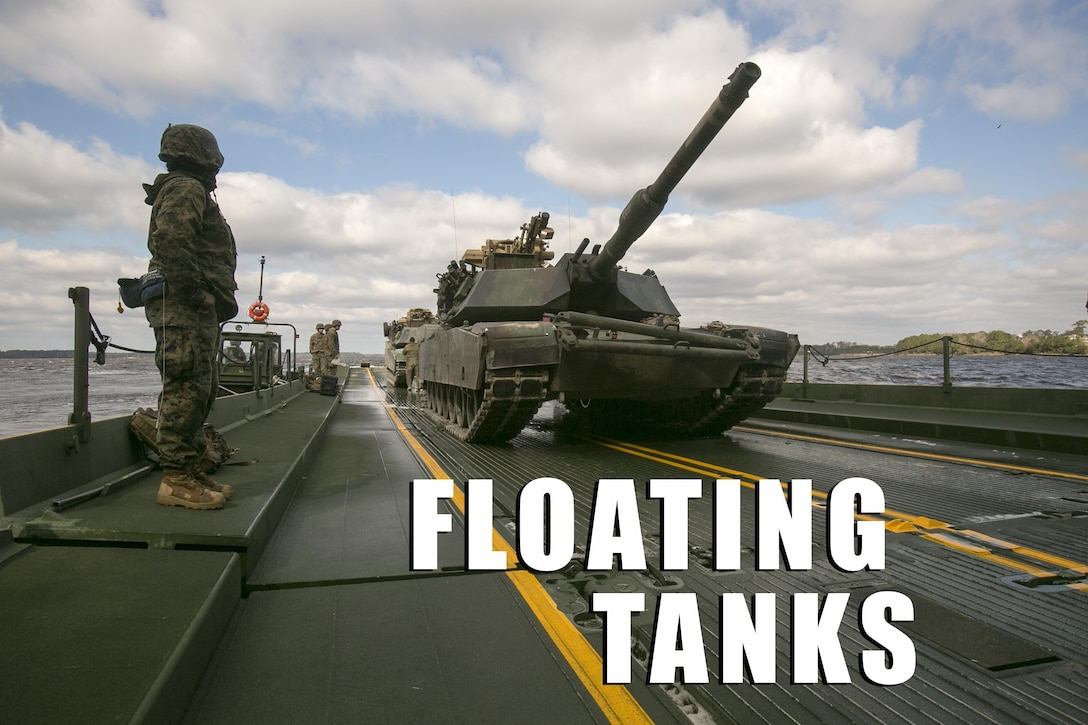 Marines with Bridge Company, 8th Engineer Support Battalion, prepare to unload two M1A1 Abrams tanks following their transport across New River by using a seven-bay raft system during a water-crossing operation at Camp Lejeune, N.C., Feb. 4, 2016. The unit boasts a wide range of raft systems and bridging that it is able to do to allow tactical vehicles to cross large bodies of water. (U.S. Marine Corps photo by Lance Cpl. Damarko Bones/Released)