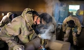 Cpl. Austin Castleman, a chemical, biological, radiological and nuclear specialist with Marine Aircraft Group 13, ensures the burner is effectively producing Chlorobenzalmalononitrile (CS) gas during Marine Aircraft Group 13 Headquarters bi-annual CBRN certification class held at the gas chamber aboard Marine Corps Air Station Yuma, Arizona, Thursday, Jan. 28, 2016.
