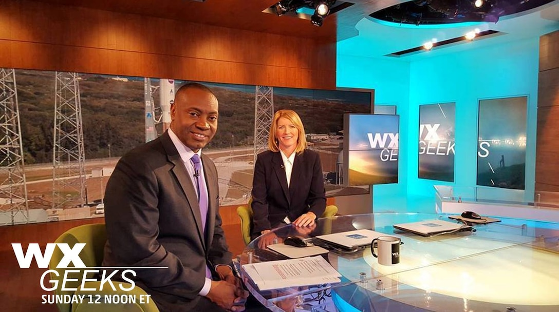 "Dr. Marshall Shepherd, a meteorologist for The Weather Channel, and Kathy Winters, a launch weather officer with the 45th Weather Squadron, discusses the unique ways their professional expertise is applied to the mission of the 45th Space Wing Dec. 17, 2015. The dialogue was filmed at the channel's studio in Atlanta, Ga., for a production that aired Jan. 10. The show also featured photos Winter's co-worker, Tech. Sgt. Matthew Mong, who was named as the show's ""Geek of the Week."" Videos of launches their team works behind the scenes to support from Cape Canaveral Air Force Station, Fla. were aired throughout the script. (Courtesy photo)"
