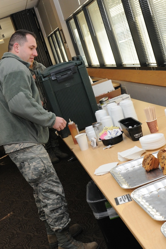 A member of the 174th Attack Wing stops by the dining facility at Hancock Field Air National Guard Base to enjoy a hot beverage and some assorted muffins, Feb. 8, 2016. (U.S. Air National Guard photo by Tech. Sgt. Justin A. Huett/Released)