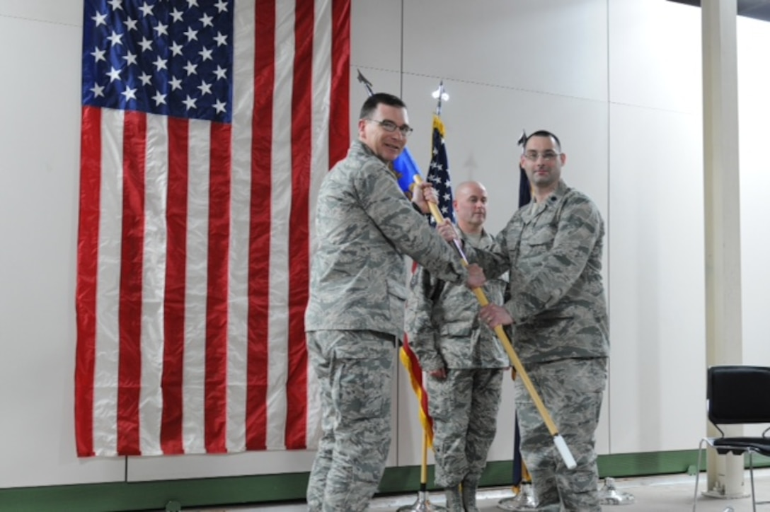Lt. Col. Judson (right) receives the Logistics Readiness Squadron guidon from Col. John O'Connor, the Mission Support Group commander, during an Assumption of Command ceremony held at Hancock Field Air National Guard Base, Feb. 5, 2016. (U.S. Air National Guard photo by Senior Airman Duane Morgan/Released)