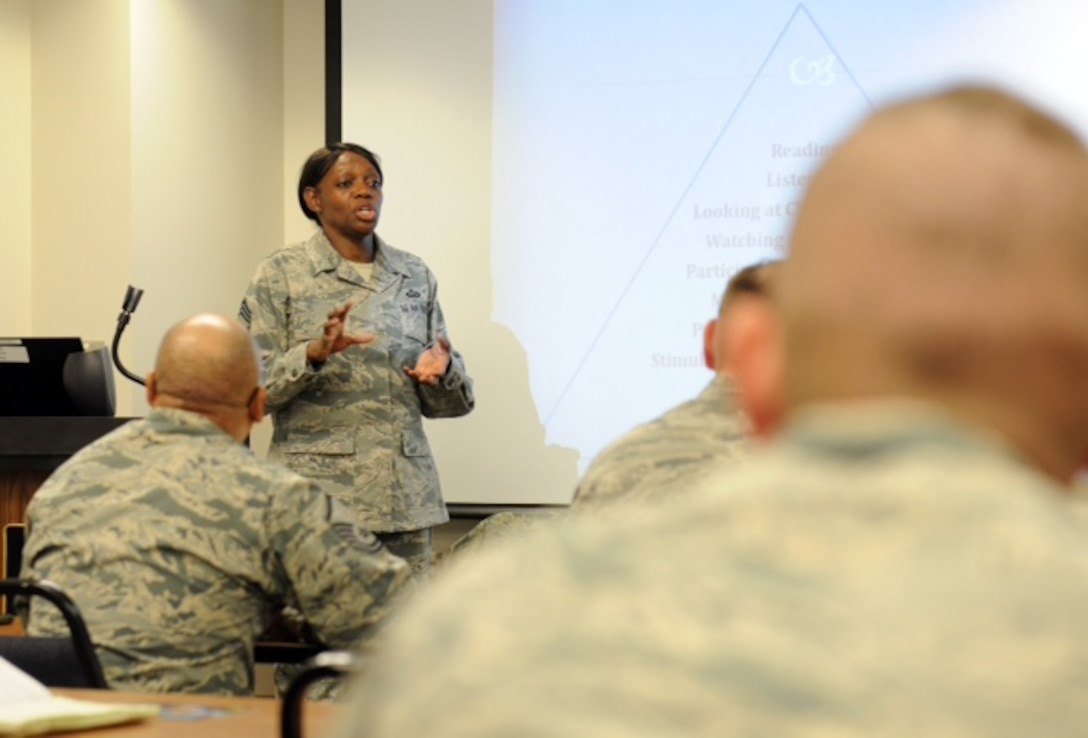 Chief Master Sgt. Sonya explains a slide during her four lenses training  class held at Hancock Field Air National Guard Base, Feb. 5, 2016. The four lenses training is designed to help members gain a better understanding of their co-workers, family, and friends though personality analysis. (U.S. Air National Guard photo by Senior Airman Duane Morgan/Released)