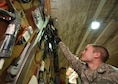 Senior Airman Christopher Litle, a 386th Expeditionary Civil Engineer Squadron Heating, Ventilation and Air Conditioning journeyman, gathers parts and tools prior to going out to a job site at an undisclosed location in Southwest Asia, Jan. 25, 2016. The HVAC flight is responsible for installing, operating, maintaining, and repairing heating, ventilation and air conditioning systems throughout the installation. (U.S. Air Force photo by Staff Sgt. Jerilyn Quintanilla