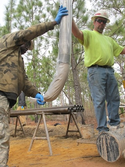 Drill Rig Assistant Lemon Moses (left) and Drill Operator John Verrett (right) bag soil samples during groundwater investigations near Fort Jackson, South Carolina Jan. 26. Soil was extracted using the TerraSonic drill rig—a piece of high-tech machinery that is the only one of its kind within USACE. The drill can be used to perform subsurface and geotechnical investigation projects on the toughest terrains throughout the nation.