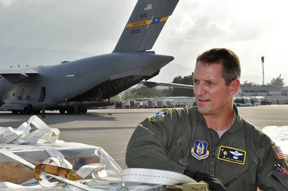 Master Sgt. Ken Hundemer, 317th Airlift Squadron loadmaster, unloads humanitarian aid from a C-17 Globemaster III while in Port Au Prince, Haiti.