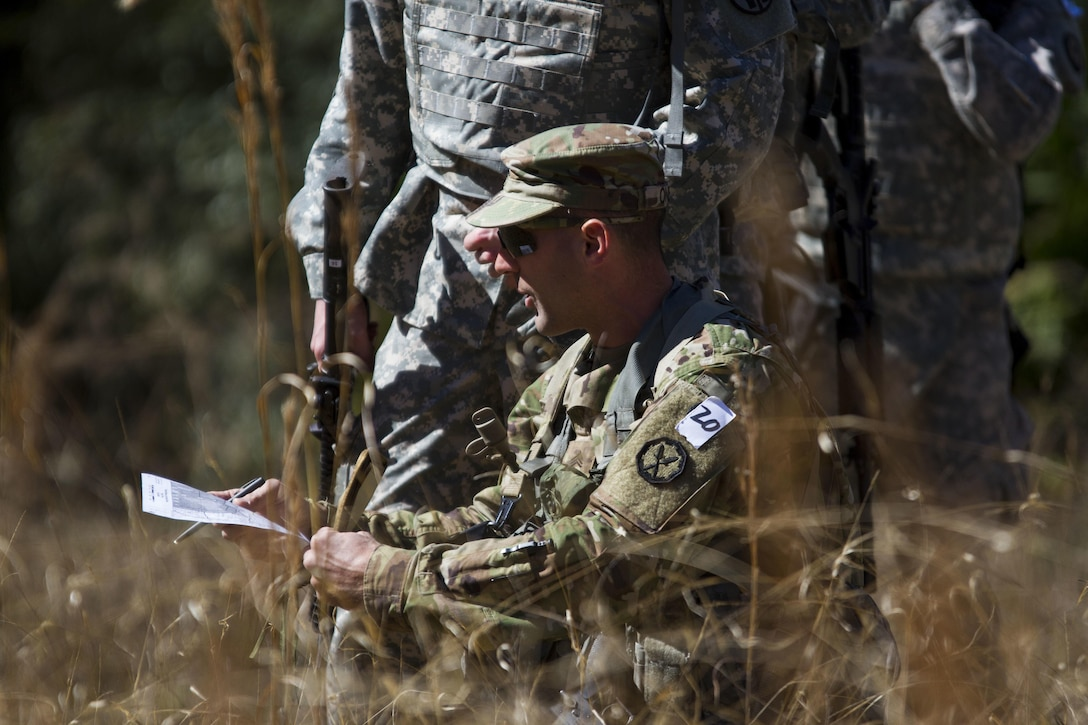 Sgt. Joseph Oneto, a military police with the 724th Military Police Detainee Operations Battalion, from Naples, Fla., orients his map before plotting points during a land navigation event at Camp Blanding, Florida, Feb. 9. The land navigation event is part of this year's 200th Military Police Command's Best Warrior Competition. The winning noncommissioned officer and junior enlisted Soldiers will move on the U.S. Army Reserve Command competition in May. (U.S. Army Photo by Sgt. Audrey Ann Hayes)