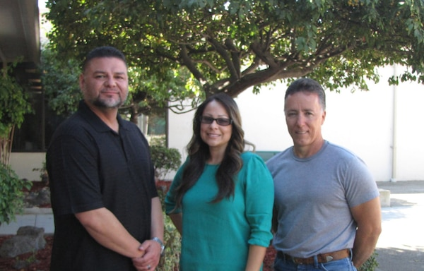 """The DLA Distribution San Joaquin FY15 Deep Dive Disposal Team, comprised of, from left to right, Abelardo """"Abe"""" Cabrera, Nyia Frisby, and Bret Goodwin, has been named the DLA Distribution Big Ideas Award winners in the """"Small"""" category for the fourth quarter of fiscal year 2015."""