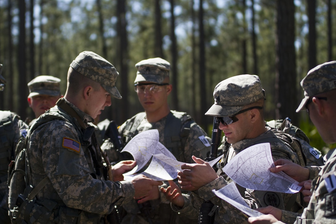 U.S. Army Reserve military police Soldiers receive maps of a land navigation course during this year's 200th Military Police Command's Best Warrior Competition at Camp Blanding, Fla., Feb. 9. Land navigation is one of the many events in the competition that reflects the competitors basic soldier skills.The winning noncommissioned officer and junior enlisted Soldiers will move on the U.S. Army Reserve Command competition in May. (U.S. Army Photo by Sgt. Audrey Ann Hayes)
