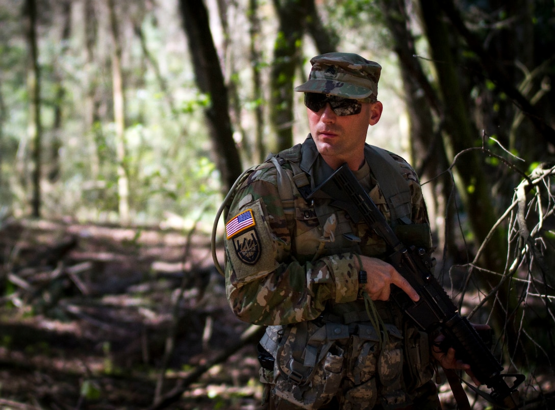 Sgt. Joseph Oneto, a military police with the 724th Military Police Detainee Operations Battalion, from Naples, Fla., contemplates which route he will take during a land navigation event, at Camp Blanding, Fla., Feb. 9. The land navigation event is part of this year's 200th  Military Police Command's Best Warrior Competition. The winning noncommissioned officer and junior enlisted Soldiers will move on the U.S. Army Reserve Command competition in May. (U.S. Army Photo by Sgt. Audrey Ann Hayes)