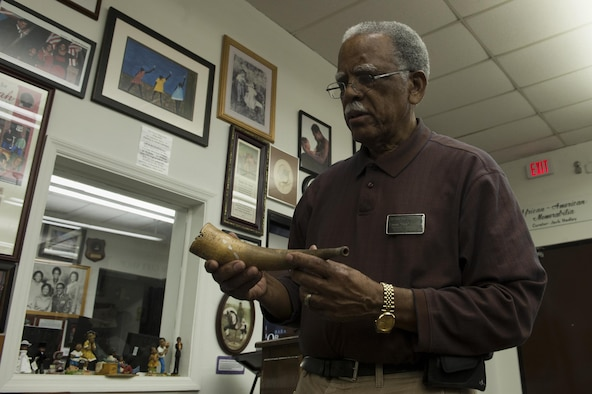 "Retired Chief Master Sgt. James ""Jack"" Hadley, Black History Museum curator, holds a signal horn, Feb. 8, 2016, at the Jack Hadley Black History Museum in Thomasville, Ga. The horn is a Hadley family heirloom which has been passed down since approximately 1850. (U.S. Air Force photo/Airman 1st Class Kathleen D. Bryant)"