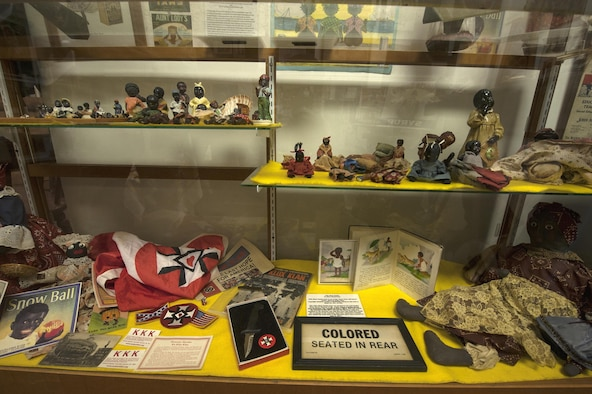 Figurines and artifacts from the Jim Crow era rest in a display case Feb. 8, 2016, at the Jack Hadley Black History Museum in Thomasville, Ga. Jim Crow laws were enacted after slavery was abolished and were used to reinforce segregation and restrict the freedom of black people. (U.S. Air Force photo/Airman 1st Class Janiqua P. Robinson)