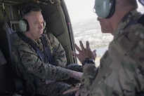 Marine Gen. Joseph F. Dunford Jr., left, chairman of the Joint Chiefs of Staff, speaks with U.S. Army Maj. Gen. Charles A. Flynn, commander of the 25th Infantry Division, aboard a UH-60 Black Hawk helicopter over Hawaii, Feb. 9, 2016. DoD Photo by Navy Petty Officer 2nd Class Dominique A. Pineiro
