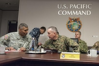 Marine Gen. Joseph F. Dunford Jr., chairman of the Joint Chiefs of Staff, speaks with Army Gen. Vincent K. Brooks, commanding general of U.S. Army Pacific, during a U.S. Pacific Command round-table discussion at the command's headquarters on Camp H.M. Smith, Hawaii, Feb. 9, 2016. DoD Photo by Navy Petty Officer 2nd Class Dominique A. Pineiro