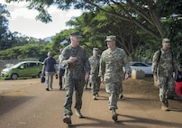 Marine Gen. Joseph F. Dunford Jr., chairman of the Joint Chiefs of Staff, speaks with Army Maj. Gen. Charles A. Flynn, commander of the 25th Infantry Division, during a tour of an exercise site on  Schofield Barracks, Hawaii, Feb. 9, 2016. DoD Photo by Navy Petty Officer 2nd Class Dominique A. Pineiro