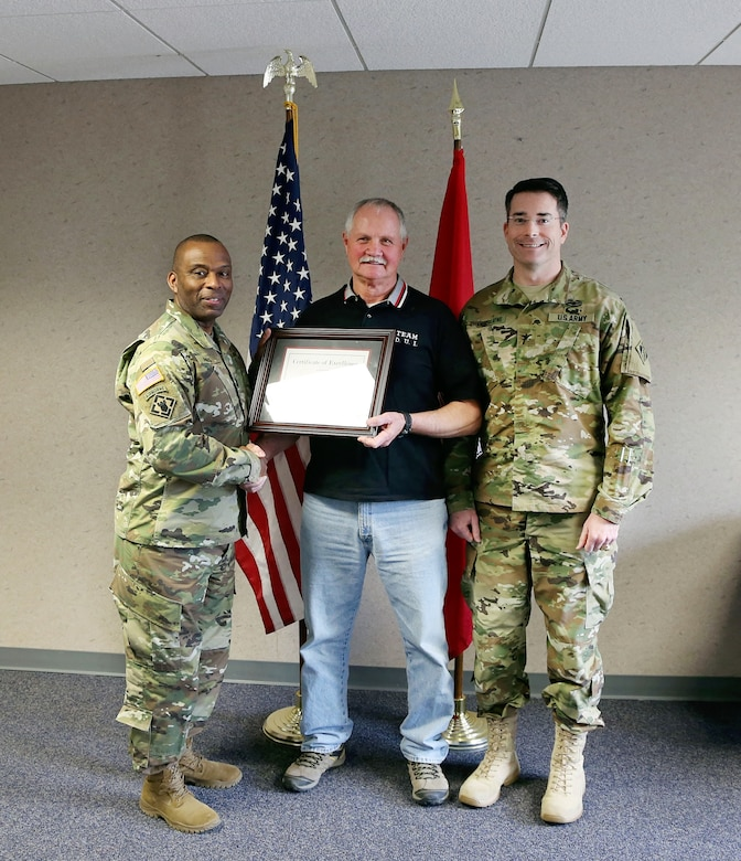 The U.S. Army Corps of Engineers (Corps) Baltimore District commander Col. Edward Chamberlayne (right) and Corps Command Sgt. Major Antonio Jones (left) honored Mr. Walter Beach, seasonal sewage and water plant operator, Tioga-Hammond & Cowanesque Lakes Project, for his heroic actions in preventing loss of life and property damage in a recognition ceremony in Tioga, Pennsylvania, February 8, 2016.   Beach was praised for taking action in June 2015, when he observed a camper failed to place her vehicle in park while unlatching from her motor home in Tompkins Campground, sending the unattended vehicle on a backwards, downhill descend towards Cowanesque Lake and multiple campsites, restroom facilities, and a playground. Beach quickly drove up the hill and struck the small vehicle with his Army Corps service vehicle, safely bringing it to a stop.  Minimal damage occurred to either vehicle, and there were no bodily injuries. (U.S. Army photo by David Gray)