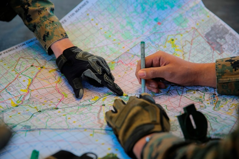 MARINE CORPS BASE CAMP PENDLETON, Calif. -- Marines plot objective points on a map to reach during a combat endurance challenge Feb. 5, 2016. The challenge consisted of hiking nearly seven miles, testing weapons systems, combat lifesaving skills, land navigation and simulated casualty evacuation. The Marines with Battery Q, 5th Battalion, 11th Marine Regiment conducted the training aboard MCB Camp Pendleton. (Marine Corps photo by Pvt. Robert Bliss)