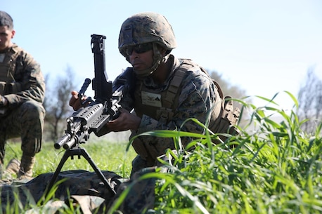 MARINE CORPS BASE CAMP PENDLETON, Calif. -- Cpl. Isaiah Phillips, a launcher crewman, performs a weapons functions test on an M240B medium machine gun during a combat endurance challenge Feb. 5, 2016. The challenge consisted of hiking nearly seven miles, testing weapons systems, combat lifesaving skills, land navigation and simulated casualty evacuation. The Marines with Battery Q, 5th Battalion, 11th Marine Regiment conducted the training aboard MCB Camp Pendleton. (Marine Corps photo by Pvt. Robert Bliss)
