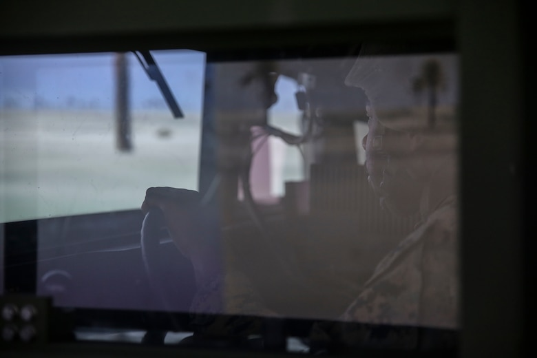 Cpl. Dequindre Jelks, a motor vehicle operator with 8th Engineer Support Battalion, drives a training Humvee during a convoy operations training simulation at Camp Lejeune, N.C., Feb. 9, 2016. Marines participated in a fully-digitized convoy simulation that allowed them to drive a high-mobility multipurpose wheeled vehicle or a seven-ton in a deployed environment. (U.S. Marine Corps photo by Cpl. Paul S. Martinez/Released)