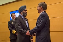 Defense Secretary Ash Carter exchanges greetings with Canadian Defense Minister Harjit Sajjan as they prepare to discuss matters of mutual importance during a bilateral meeting at NATO headquarters in Brussels, Feb. 10, 2016. DoD photo by Air Force Senior Master Sgt. Adrian Cadiz