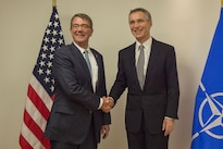 Defense Secretary Ash Carter exchanges greetings with NATO Secretary General Jens Stoltenberg at NATO headquarters in Brussels, Feb. 10, 2016. DoD photo by Air Force Senior Master Sgt. Adrian Cadiz
