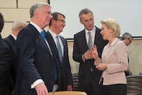 Defense Secretary Ash Carter speaks with British Defense Secretary Michael Fallon, left, NATO Secretary General Jens Stoltenberg, center right, and German Defense Minister Ursula von der Leyen as he arrives at a North Atlantic Council meeting at NATO headquarters in Brussels, Feb. 10, 2016. DoD photo by Air Force Senior Master Sgt. Adrian Cadiz