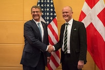 Defense Secretary Ash Carter exchanges greetings with Danish Defense Minister Peter Christensen as they prepare to discuss matters of mutual importance at NATO headquarters in Brussels, Feb. 10, 2016. DoD photo by Air Force Senior Master Sgt. Adrian Cadiz