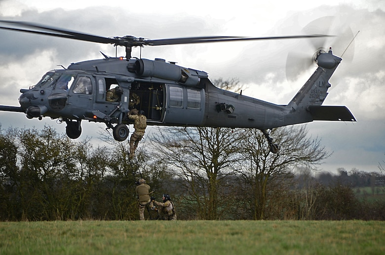 Pararescuemen assigned to the 57th Rescue Squadron climb into an HH-60G Pave Hawk during a combat search and rescue task force training exercise near Hinderclay, England, Feb. 4, 2016. The training simulated a downed pilot in a hostile environment that required employment of 56th and 57th RQS personnel for recovery assistance. (U.S. Air Force photo/Senior Airman Erin Trower)