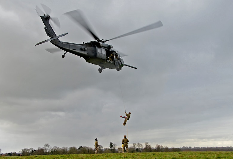 A 57th Rescue Squadron pararescueman is hoisted into an HH-60G Pave Hawk during a combat search and rescue task force exercise near Hinderclay, England, Feb. 4, 2016. Airmen assigned to the 56th and 57th RQSs performed various CSAR maneuvers in response to a simulated threat scenario. (U.S. Air Force photo/Senior Airman Erin Trower)