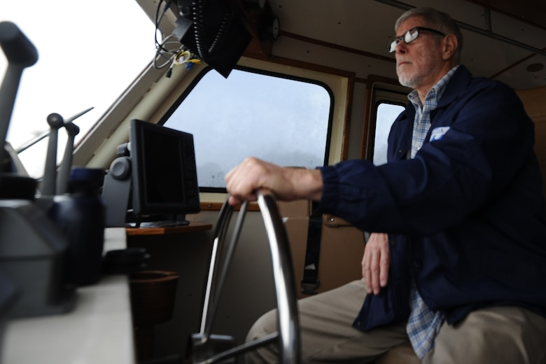 Ray Gallien, 82nd Aerial Targets Squadron Florida off-shore incorporated manager, sits behind a 120-foot drone recovery vessel's helm Feb. 4 at the Bonita Bay 82nd ATRS water recovery operations facility. It is this facility's responsibility to recover downed BQM-167 subscale drones used in simulated air-to-air combat. (U.S. Air Force photo by Senior Airman Ty-Rico Lea)