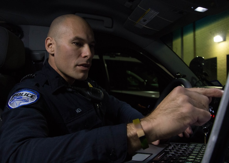 Steven Hein, a police officer with the Richardson Police Department, inspects his vehicle prior to a patrol in Richardson, Texas, Jan. 28, 2016. Hein will be a two-time competitor at the 2016 Best Warrior Competition. (Texas Air National Guard photo by Tech. Sgt. Vanessa Reed/ Released)