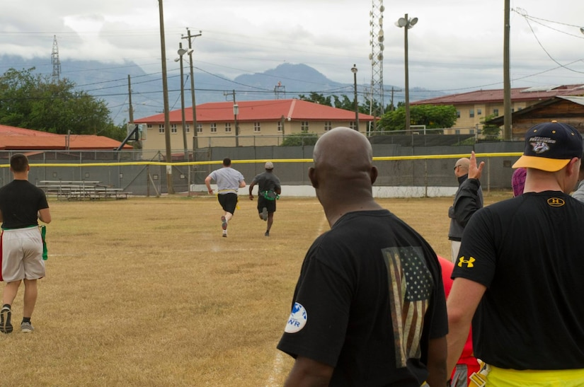 Keith Tandy, Tampa Bay Buccaneers safety, outruns a member of the 612th Air Base Squadron team during a game of flag football with Servicemembers Feb. 6, 2016 at Soto Cano Air Base, Honduras, as a part of a visit to the base hosted by the Armed Forces Entertainment for Super Bowl 50. (U.S. Air Force photo by Capt. Christopher Mesnard/Released)