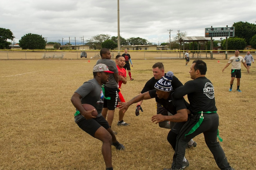 Pictured left, Keith Tandy, Tampa Bay Buccaneers safety, plays a game of flag football with Servicemembers Feb. 6, 2016 at Soto Cano Air Base, Honduras, as a part of a visit to the base hosted by the Armed Forces Entertainment for Super Bowl 50. (U.S. Air Force photo by Capt. Christopher Mesnard/Released)