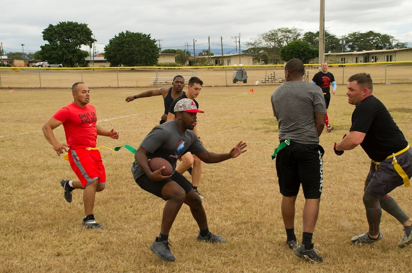 Pictured center, Keith Tandy, Tampa Bay Buccaneers safety, plays a game of flag football with Servicemembers Feb. 6, 2016 at Soto Cano Air Base, Honduras, as a part of a visit to the base hosted by the Armed Forces Entertainment organization for Super Bowl 50. (U.S. Air Force photo by Capt. Christopher Mesnard/Released)