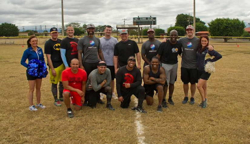Servicemembers with the Army Force Battalion at Soto Cano Air Base, Honduras, pose for a photo with NFL players and cheerleaders after a game of flag football Feb. 6, 2016, as a part of a visit to the base hosted by the Armed Forces Entertainment for Super Bowl 50. (U.S. Air Force photo by Capt. Christopher Mesnard/Released)
