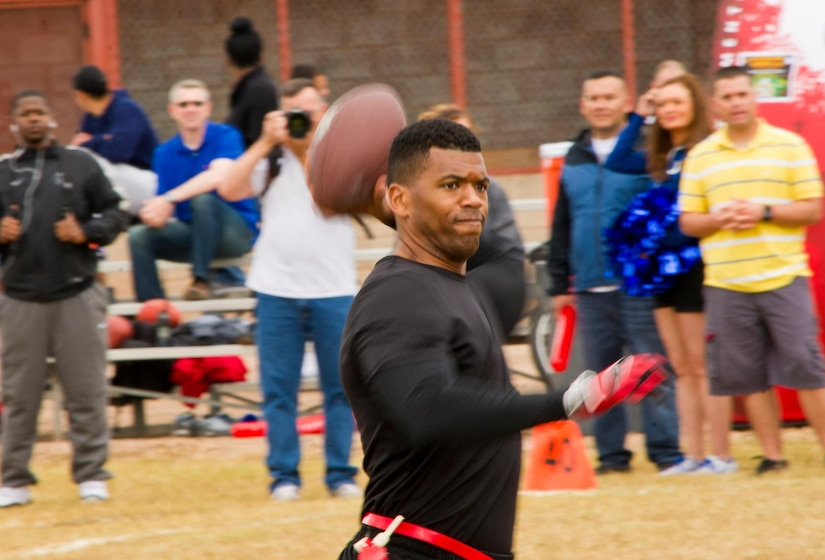 U.S. Air Force Master Sgt. Philip Rush, 612th Air Base Squadron Air Traffic Control and Landing System section chief passes a ball during a flag football game Feb. 6, 2016 at Soto Cano Air Base, Honduras, as a part of an NFL player and cheerleader visit with the Armed Forces Entertainment organization for Super Bowl 50. (U.S. Air Force photo by Capt. Christopher Mesnard/Released)